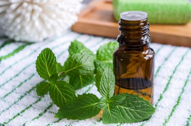 a small bottle of peppermint essential oil, a natural remedy to make nausea go away