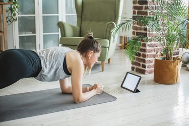 Woman exercising with workout program.