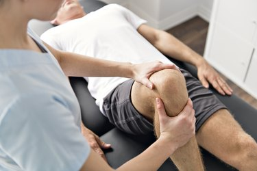 Patient doing physical exercises with his physical therapist