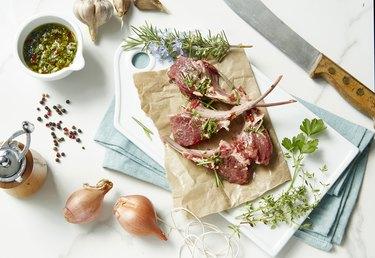 Raw fresh lamb chops with herbs and gremolata
