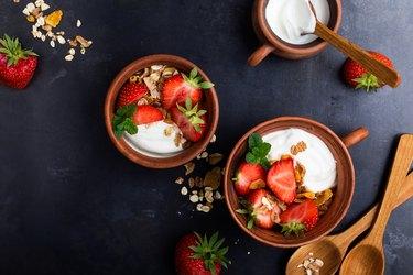 Breakfast with muesli, yogurt and fresh strawberries