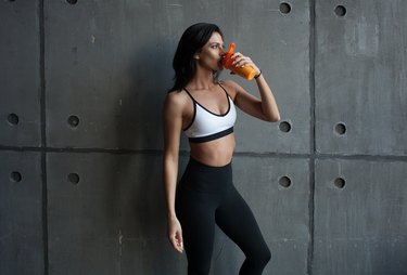 female athlete drinking protein drink