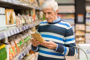 Elderly man shopping cereals in the store