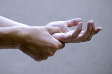 Man holding hand joint in pain. Medical health issue.Close up,isolated young man hands