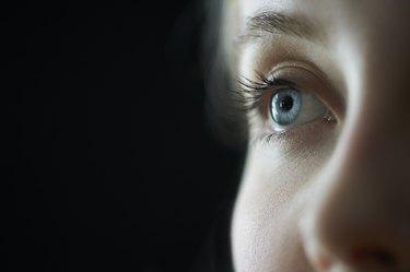 Female blue eye close up.