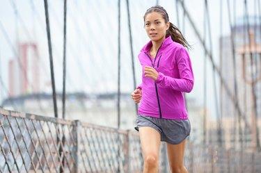 Female runner running and jogging in New York City