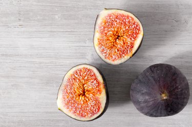 Figs on the white wooden table top view