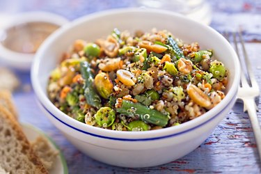 Quinoa, spelt, peanuts, almond, pistachios salad with soy and ginger dressing
