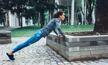 Woman doing push-ups outdoors