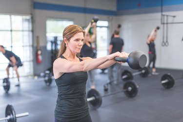 Woman doing a superset HIIT workout for beginners