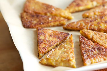 Fried Tempeh Triangles on Parchment Paper