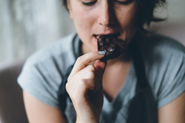 Woman eating chocolate and sweating while eating