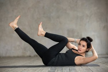 Young woman doing criss-cross exercise