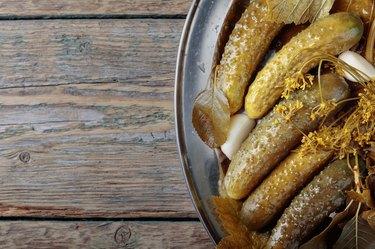 Homemade pickled cucumbers in brine.