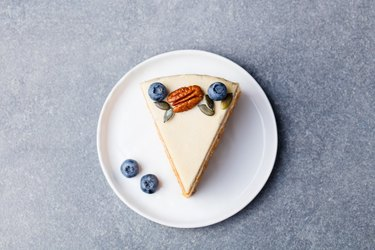 Vegan, raw carrot cake. Healthy food. Grey stone background. Top view.