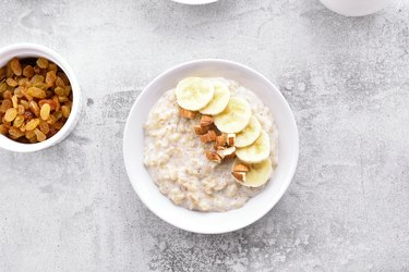 Oats porridge with banana slices and nuts