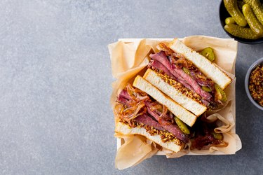 Sandwich with roast beef in wooden box. Top view. Copy space.