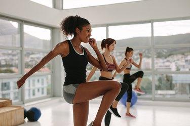 Multi ethnic  women exercises in gym class