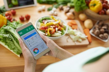 woman using a calorie counting app as a form of dieting
