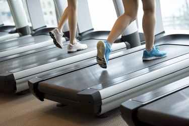 Two women running on the treadmills