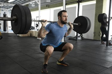 Man squatting with proper form.