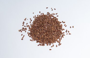 Flax Seeds Over White Background