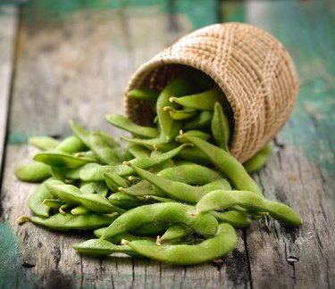 green soy beans in the basket on wooden