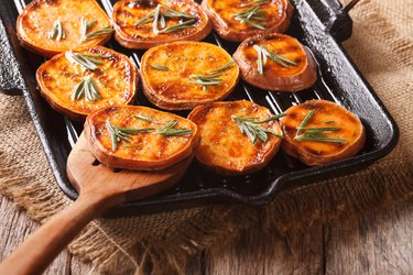 Grilled sweet potato rounds with rosemary on a grill pan