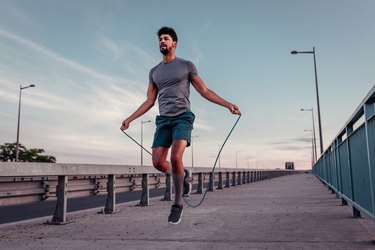 Man doing a 20-minute jump rope workout outside