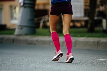 back women feet in pink compression socks
