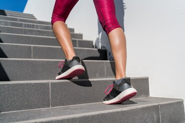 Running shoes runner woman walking up stairs