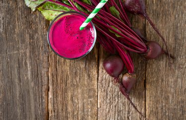 beetroot juice on wooden surface