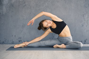 Relaxed girl streching arms and legs at her home