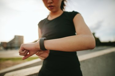 Woman checking her performance on smartwatch looking to lose weight fast