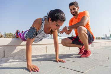 Fitness couple exercising outdoors