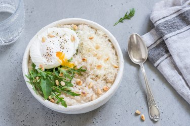 Savory oatmeal with poached egg and arugula