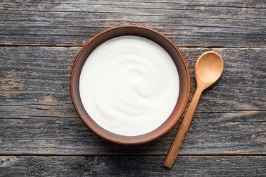 Natural yogurt in ceramic bowl