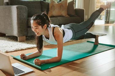 A woman working out at home using the Beachbody program