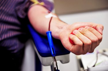 Close view of a person's arm during blood donation