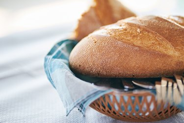 Close-Up Of Tasty Homemade Bread In Wooden Basket