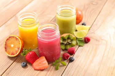 assorted fruit juice on wooden table