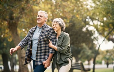 An older couple enjoying time together outside in a park