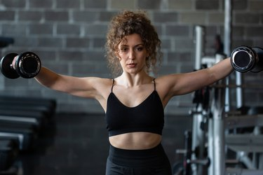Woman exercising in gym.