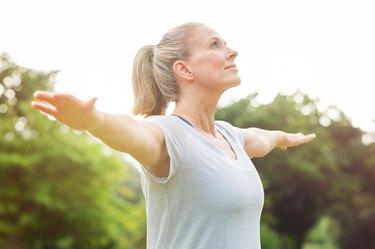 Mature woman doing yoga exercise for arthritis