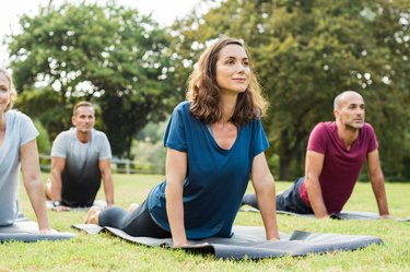 A group of people practicing yoga outdoors
