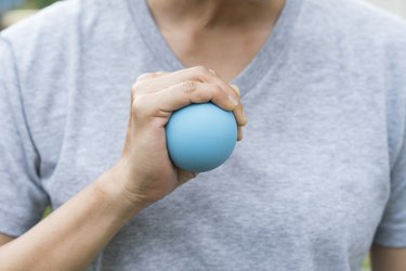 woman hand holding a stress ball