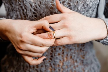 woman takes off a ring