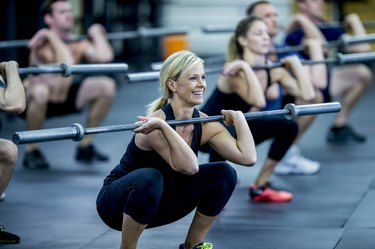 woman with a barbell doing a cold workout