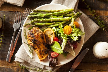 Homemade Lemon and Herb Chicken with asparagus on side and salad