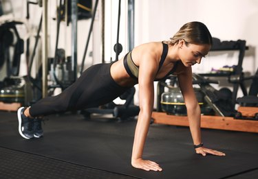 Woman practicing plank pose